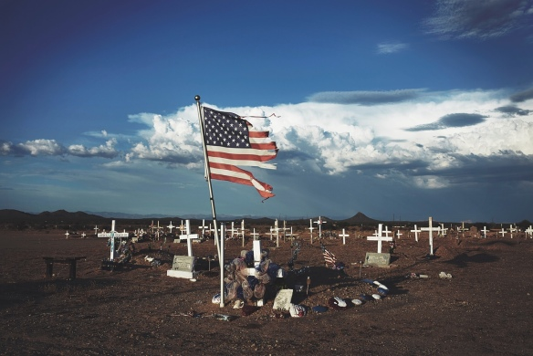 A shredded American flag at a grave site in Blackwater, Arizona. Photograph: Steve Craft for the Guardian