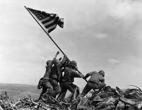 Ira Hayes and other US marines raise the American flag on Mount Suribachi, on the Pacific island of Iwo Jima in 1945. Photograph: Joe Rosenthal/AP