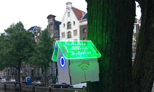 The TreeWifi birdhouse glows green – and gives passersby free Wi-Fi - when the air quality is high. Photograph: Joris Lam/TreeWifi