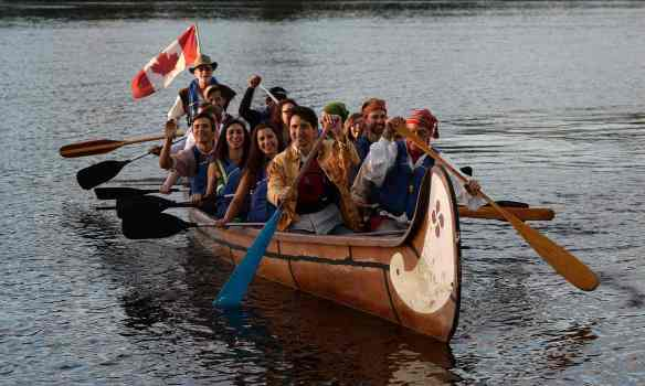 Want to migrate to Canada? Hop on a canoe with prime minister Justin Trudeau. Photograph: Sean Kilpatrick/AP