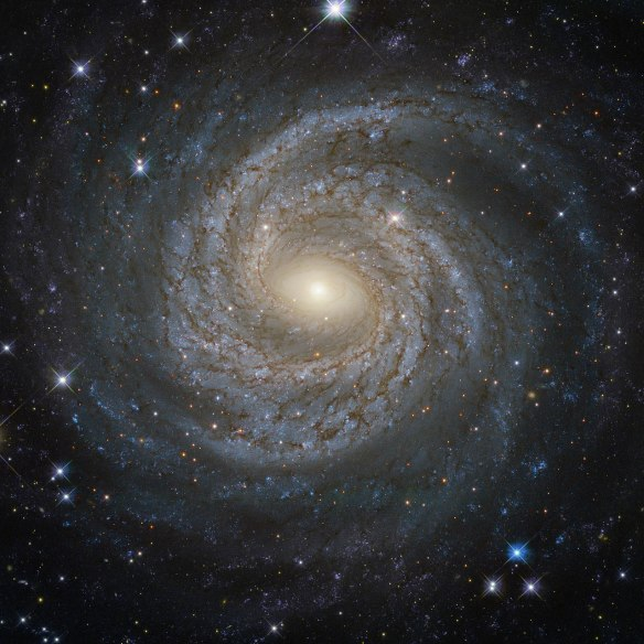 """If confirmed by further experiments, this discovery of a possible fifth force would completely change our understanding of the universe,"" says UCI professor of physics & astronomy Jonathan Feng, including what holds together galaxies such as this spiral one, called NGC 6814. ESA/Hubble & NASA; Acknowledgement: Judy Schmidt Spiral galaxies together with irregular galaxies make up approximately 60% of the galaxies in the local Universe. However, despite their prevalence, each spiral galaxy is unique Ñ like snowflakes, no two are alike. This is demonstrated by the striking face-on spiral galaxy NGC 6814, whose luminous nucleus and spectacular sweeping arms, rippled with an intricate pattern of dark dust, are captured in this NASA/ESA Hubble Space Telescope image. NGC 6814 has an extremely bright nucleus, a telltale sign that the galaxy is a Seyfert galaxy. These galaxies have very active centres that can emit strong bursts of radiation. The luminous heart of NGC 6814 is a highly variable source of X-ray radiation, causing scientists to suspect that it hosts a supermassive black hole with a mass about 18 million times that of the Sun. As NGC 6814 is a very active galaxy, many regions of ionised gas are studded along Êits spiral arms. In these large clouds of gas, a burst of star formation has recently taken place, forging the brilliant blue stars that are visible scattered throughout the galaxy. Image credit: ESA/Hubble & NASA; Acknowledgement: Judy Schmidt Text credit: European Space Agency"