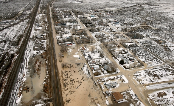 On Wednesday, Feb. 8, 2017, 21 Mile Dam near Montello, Nev., broke and caused flooding to the Union Pacific railroad line near Lucin and flooded the town of Montello, Nev. The floods forced delays or rerouting for more than a dozen freight and passenger trains on a main rail line that runs through the area, said Union Pacific spokesman Justin E. Jacobs.(Stuart Johnson/The Deseret News via AP)/The Deseret News via AP) NYTCREDIT: Stuart Johnson/The Deseret News, via Associated Press