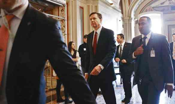 FBI director James Comey leaves a meeting on Capitol Hill on Friday in Washington DC. Photograph: Mario Tama/Getty Images