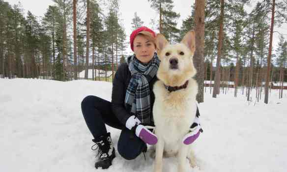 Mari Saarenpää with her dog Oiva in Paltamo, Finland. She was randomly selected to take part in the basic income experiment. Photograph: Tuomas Härkönen