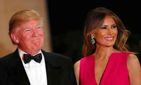 Donald Trump and first lady Melania Trump at Mar-a-Lago club in Palm Beach, on Saturday where he told reporters: 'For the safety of the country, we'll win.' Photograph: Carlos Barria/Reuters