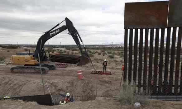 Trump has said he will ask Congress to pay for what existing funds cannot cover and that Mexico will be pressured to pay back US taxpayers at a later date. Photograph: Christian Torres/AP